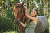 Young woman close-up with horse — Stock Photo