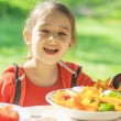 Постер, плакат: Young Girl eats vegetables