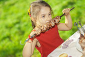 Young girl eats kebab — Stock Photo