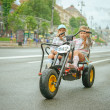 Two little girls riding toy cycle — Stock Photo #44386231