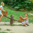 Two sisters ride on swings — Stock Photo #44386561