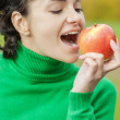 Girl bites off an apple — Stock Photo #45201905