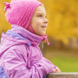 Pretty little girl in autumn park — Stock Photo #45620251