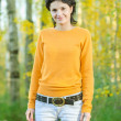 Girl in yellow sweater — Stock Photo
