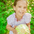 Little girl holding cabbage — Stock Photo