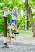 Little beautiful girl involved in sports trainer — Stock Photo