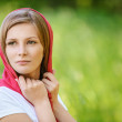 Portrait of young smiling woman wearing kerchief — Stock Photo #46236637