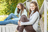 Two young and beautiful girls at banisters — Stock Photo