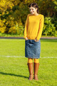 Girl in yellow sweater — Stock Photo