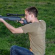 Постер, плакат: Man took aim with your sniper rifle