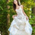 Beautiful bride in white wedding dress — Stock Photo #47413159