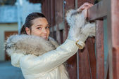 Beautiful woman in a white coat — Stock Photo