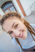 Girl with dreadlocks laughs — Stock Photo