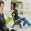 Young couples on bench — Stock Photo