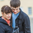 Man and woman looking sms cell phone — Stock Photo #47735841