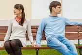 Man and woman sitting on bench — Stock Photo