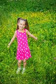 Little girl in green summer city park — Stock Photo