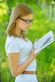 Portrait of young beautiful woman holding book — Stock Photo