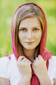 Portrait of young smiling woman wearing kerchief — Stock Photo