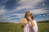 Girl beats fist — Stock Photo