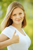 "Young woman showing ""cool"" signs — Stock Photo"