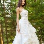 Beautiful bride in white wedding dress — Stock Photo #48635999
