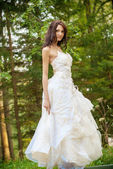 Beautiful bride in white wedding dress — Stok fotoğraf