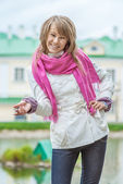 Girl with pink scarf — Stock Photo