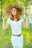 Close-up portrait of smiling woman wearing hat — Stock Photo