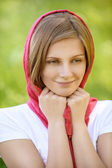 Portrait of young smiling woman wearing kerchief — Photo