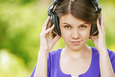 Close-up portrait of young woman wearing headphones — Stock Photo