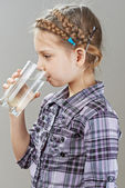 Little girl is drinking water — Stock Photo