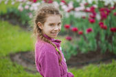 Pretty little girl in tulip park — Stock Photo