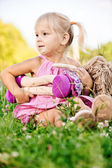 Little girl rocks to sleep the doll — Stock Photo