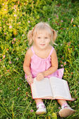 Little girl reads book. — Stock Photo