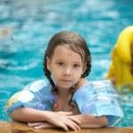 Little girl in inflatable waistcoat — Stock Photo #49529953