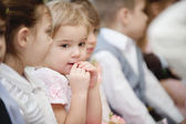 Preschool children sits in kindergarten — Stockfoto