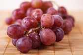 Closeup red large bunch grapes — Stock Photo