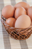 Wicker basket with chicken eggs — Stock Photo