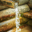 Wooden trough on holy spring — Stock Photo #50083647