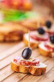 Sausage sandwiches, cheese and olives — Stock Photo