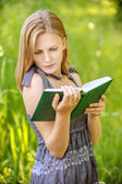 Beautiful young blond woman with book — Stock Photo