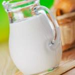 Постер, плакат: Pone bun pitcher of milk