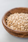Oat flakes in bowl — Stock Photo