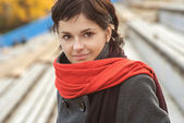 Beautiful girl with red scarf — Stock Photo