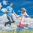 Young woman jumping with a man — Stock Photo #50975973