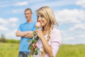 Young man gave rose girl — Stock Photo