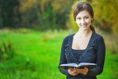 Girl with book in hands — Stock Photo