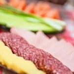 Abundance food cheese,sausage,bread, green onions,tomatoes, cucu — Stock Photo #51143541