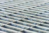 Metal grille in front of door — Foto de Stock